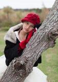 κορίτσι φορεμάτων που παίζει επάνω Στοκ Φωτογραφίες