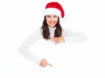 Κορίτσι Χριστουγέννων αρωγών Santa με το έμβλημα. Στοκ φωτογραφία με δικαίωμα ελεύθερης χρήσης