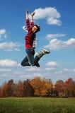 κορίτσι jumpinp Στοκ Εικόνες