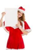 Κορίτσι Santa πίσω από το κενό έγγραφο Στοκ Φωτογραφία