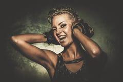 Κορίτσι Steampunk με τα ακουστικά Στοκ Φωτογραφίες