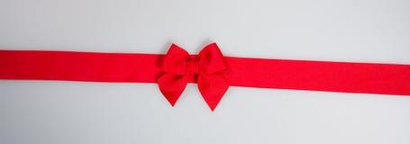 κορδέλλα ή κόκκινη κορδέλλα σε ένα υπόβαθρο Στοκ Εικόνες