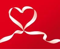 κορδέλλα καρδιών δώρων ε&omic Στοκ Φωτογραφίες