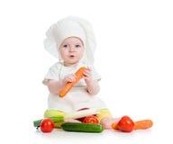 Κοριτσάκι μαγείρων που τρώει τα υγιή τρόφιμα Στοκ Εικόνες
