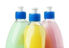 Κορυφή τριών διαφορετική χρωματισμένη μπουκαλιών που απομονώνεται στο λευκό Στοκ Φωτογραφία