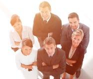 κορυφαία όψη Επιτυχής επιχειρησιακή ομάδα που εξετάζει τη κάμερα Στοκ Εικόνα