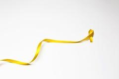 Κορδέλλα παιδικής ηλικίας, χρυσή κορδέλλα ως σύμβολο του καρκίνου παιδικής ηλικίας awar Στοκ Εικόνες