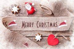 Κορδέλλα Χριστουγέννων στο ξύλινο υπόβαθρο Στοκ φωτογραφία με δικαίωμα ελεύθερης χρήσης