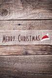 Κορδέλλα Χριστουγέννων στο ξύλινο υπόβαθρο Στοκ εικόνες με δικαίωμα ελεύθερης χρήσης