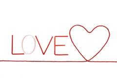 Κορδέλλες που διαμορφώνονται ως αγάπη κειμένων Στοκ φωτογραφία με δικαίωμα ελεύθερης χρήσης
