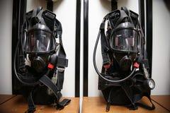 Κοστούμι και εξοπλισμός πυροσβεστών έτοιμοι για τη λειτουργία Στοκ Εικόνες