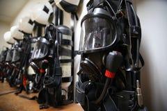 Κοστούμι και εξοπλισμός πυροσβεστών έτοιμοι για τη λειτουργία Στοκ Φωτογραφία