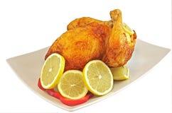 Κοτόπουλο που τηγανίζεται με το λεμόνι στοκ εικόνες με δικαίωμα ελεύθερης χρήσης