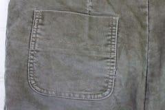 Κοτλέ τσέπη τζιν λεπτομέρειας υφάσματος ιματισμού Στοκ Φωτογραφίες