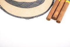 Κουβανικά πούρο και καπέλο Στοκ Φωτογραφία