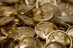 κουμπί ανασκόπησης χρυσό Στοκ Εικόνες
