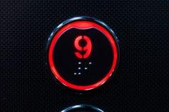 Κουμπί ανελκυστήρων με μπράιγ στρογγυλό κουμπί εννέα στοκ εικόνες