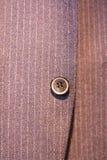 Κουμπί στο κοστούμι Στοκ Φωτογραφίες