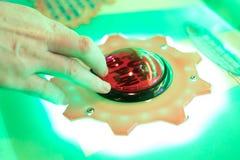 Κουμπί ώθησης για να παίξει arcade Στοκ Φωτογραφία