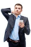 Κουρασμένος επιχειρηματίας με το τηλέφωνο διαθέσιμο στο λευκό Στοκ φωτογραφία με δικαίωμα ελεύθερης χρήσης