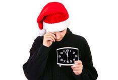 Κουρασμένος νεαρός άνδρας στο καπέλο Santa Στοκ Εικόνα