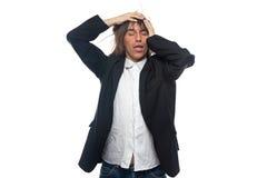 Κουρασμένος νεαρός άνδρας σχετικά με το κεφάλι του Στοκ Φωτογραφία