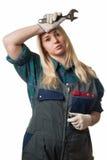 Κουρασμένος ξανθός με τα εργαλεία Στοκ φωτογραφία με δικαίωμα ελεύθερης χρήσης