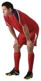 Κουρασμένος ποδοσφαιριστής που κάμπτει Στοκ Φωτογραφία