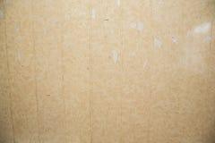 Κουρελιασμένη μπεζ επιτροπή τοίχων Στοκ φωτογραφία με δικαίωμα ελεύθερης χρήσης