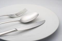 κουτάλι ασημικών πιάτων μα&ch Στοκ Εικόνες