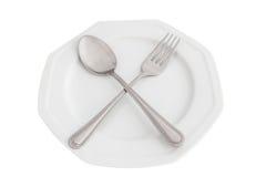 Κουτάλι, δίκρανο και πιάτο Στοκ εικόνα με δικαίωμα ελεύθερης χρήσης
