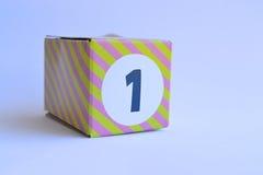 Κουτί από χαρτόνι με τον αριθμό ένας Στοκ Φωτογραφία