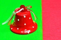 Κουδούνι στο χρωματισμένο υπόβαθρο Στοκ Φωτογραφία