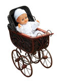 Κούκλα στο εκλεκτής ποιότητας καροτσάκι Στοκ φωτογραφία με δικαίωμα ελεύθερης χρήσης