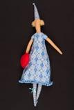 Κούκλα με την κόκκινη τσάντα στοκ φωτογραφία