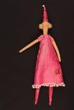 Κούκλα στο κόκκινο φόρεμα στοκ φωτογραφία με δικαίωμα ελεύθερης χρήσης