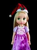 Κούκλα Santy, ένα καπέλο santa ένδυσης κουκλών Στοκ Εικόνες