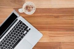 Κούπα του καφέ και του lap-top Στοκ Εικόνα