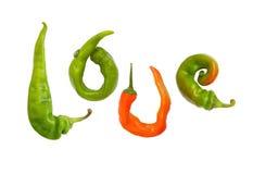 Κολάζ - αγάπη των πιπεριών τσίλι σε ένα άσπρο υπόβαθρο Στοκ Εικόνες