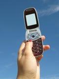 κράτημα του κινητού τηλεφώνου Στοκ φωτογραφία με δικαίωμα ελεύθερης χρήσης