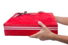 Κράτημα του κόκκινου πλαισίου IV δώρων Στοκ Εικόνες