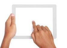 Κράτημα χεριών και σχετικά με στο PC ταμπλετών Στοκ Εικόνες