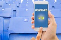 Κράτηση ενός καθίσματος με ένα τηλέφωνο Στοκ φωτογραφία με δικαίωμα ελεύθερης χρήσης