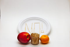 Κρίσιμος τρώγων - Apple και πορτοκάλι Στοκ Εικόνα