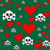 Κρανία και καρδιές στο πράσινο άνευ ραφής σχέδιο στοκ φωτογραφίες