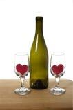 κρασί καρδιών γυαλιών μπουκαλιών Στοκ Εικόνα
