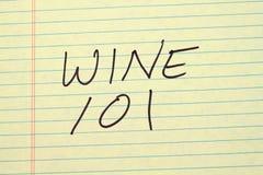 Κρασί 101 σε ένα κίτρινο νομικό μαξιλάρι Στοκ εικόνες με δικαίωμα ελεύθερης χρήσης