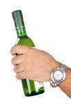 κρασί χεριών μπουκαλιών στοκ φωτογραφία