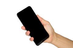 Κρατώντας το έξυπνο τηλέφωνο κινητό Στοκ φωτογραφίες με δικαίωμα ελεύθερης χρήσης