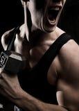 κραυγή μυών αθλητών Στοκ Εικόνες